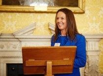 Melanie Waters, Poppy Factory CEO, speaking at an event for veterans on Whitehall.
